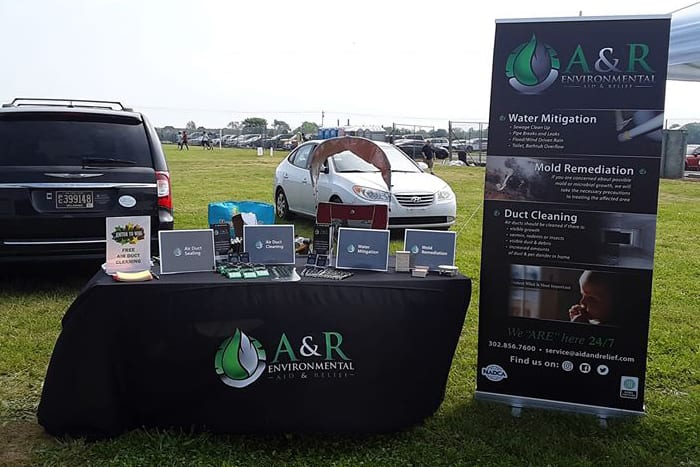A&R Environmental Aid & Relief booth at community event